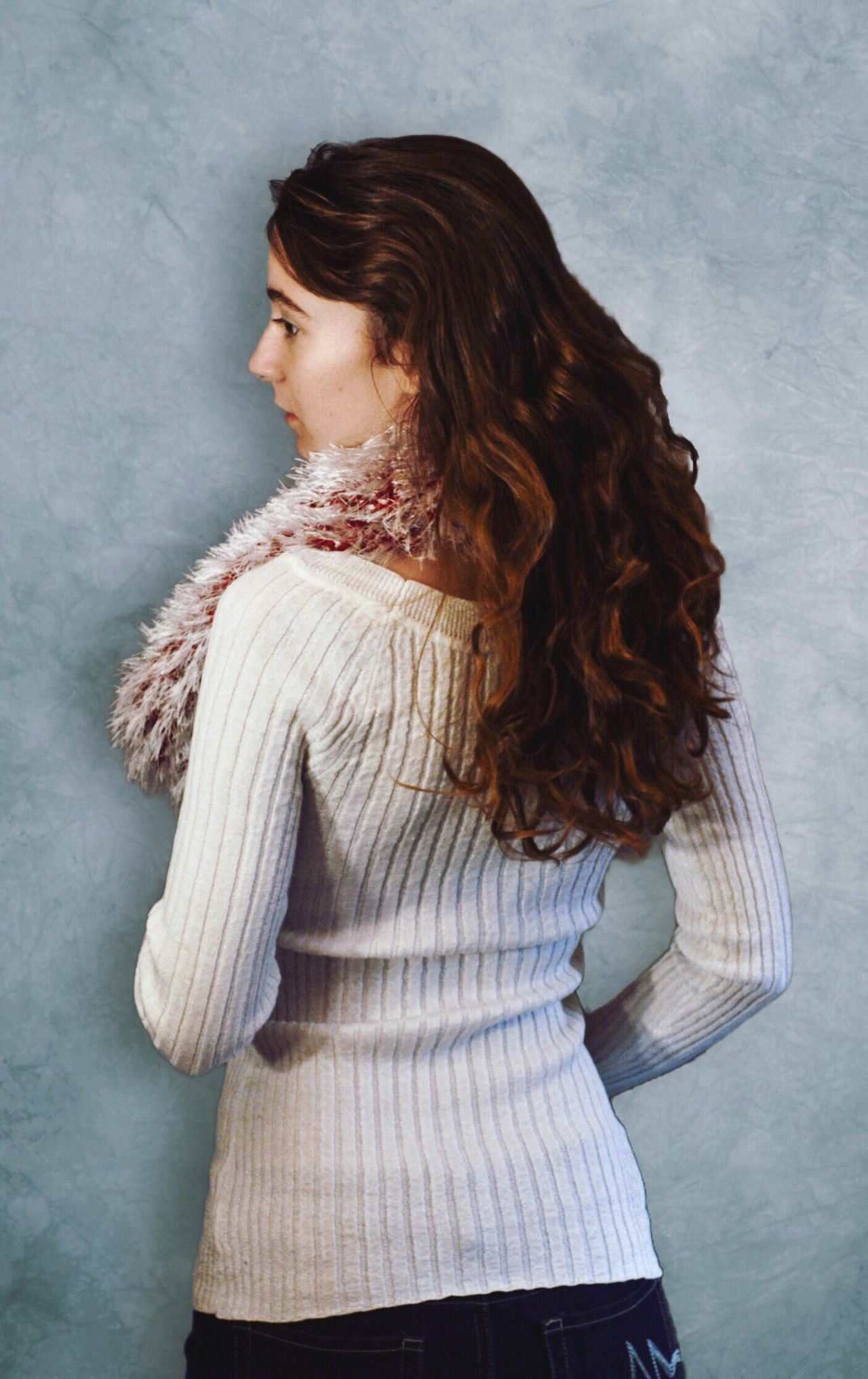 Woman with long wavy hair One Person Standing Three Quarter Length Long Hair Looking Away Casual Clothing Lifestyles Real People Young Adult Beautiful Woman Young Women Beauty Indoors  Only Women People Adults Only Adult Model Fashion Winter Fashion White Color Brunette Long Hair Curly Hair Wavy Hair