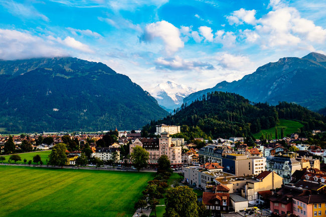 Architecture Beauty In Nature Blue Building Exterior Built Structure Cloud Cloud - Sky Cloudy Day Green Color Growth Interlaken Jungfrau Jungfrau - Top Of Europe Mountain Mountain Range Nature Outdoors Residential District Scenics Sky Switzerland Town Tranquil Scene Tranquility