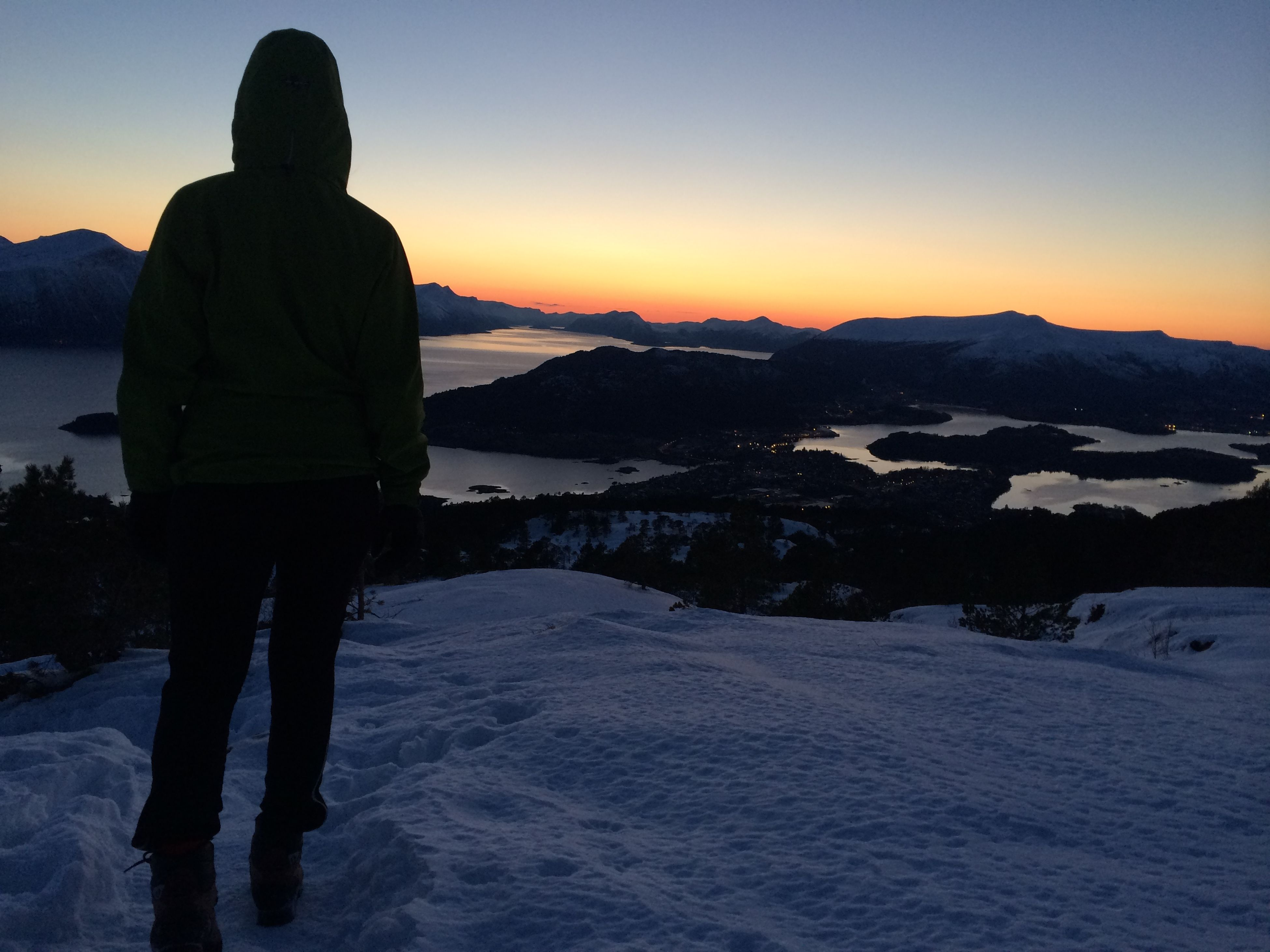 snow, sunset, winter, cold temperature, lifestyles, silhouette, standing, tranquil scene, leisure activity, scenics, tranquility, beauty in nature, mountain, season, sky, nature, full length, rear view