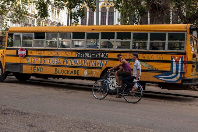 The Photojournalist - 2016 EyeEm Awards sCuba Collection y]Transportation Travel Yellow Y[a:bus gCity Life Cuba oCuban hCuban Flag rFlag sHavana 1Mode Of Transport bPlaing ePlaing Time