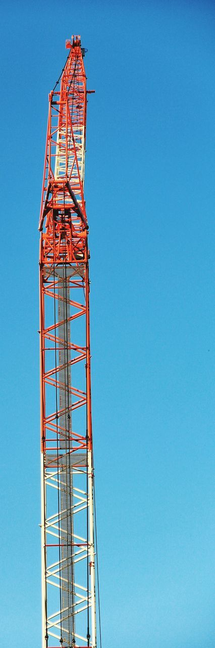 construction site, architecture, copy space, development, construction, built structure, day, low angle view, crane - construction machinery, blue, no people, clear sky, outdoors