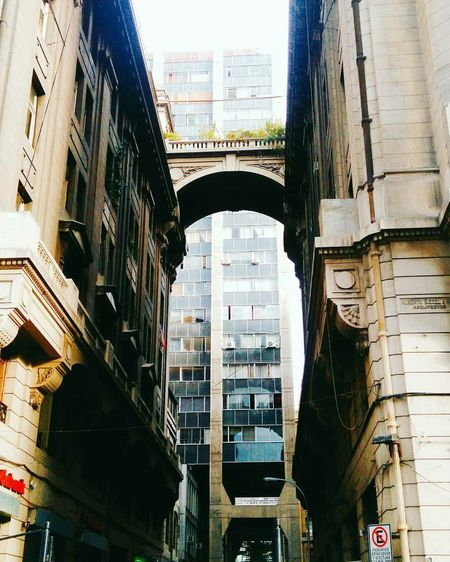 Architecture City Arch Built Structure City Street Bridge - Man Made Structure City Life Building Exterior Day Cityscape Outdoors Low Angle View Skyscraper Photography Photo No People Santiago De Chile EyeEmNewHere Art Is Everywhere Break The Mold Chile Visual Feast Neighborhood Map The Architect - 2017 EyeEm Awards The Street Photographer - 2017 EyeEm Awards
