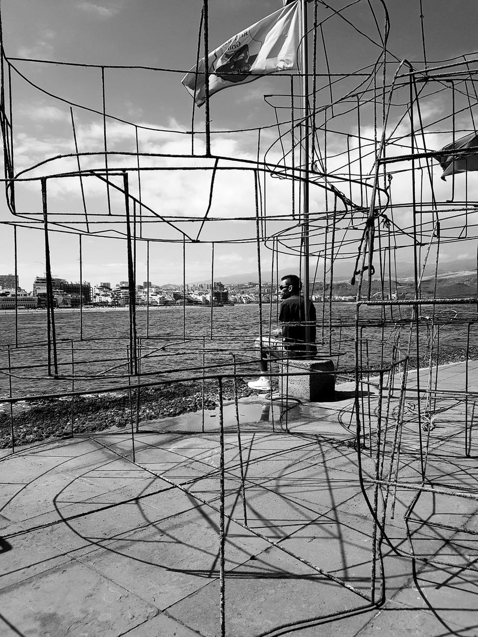 Caged Outdoors Day Sky Seashore Seafront Ocean One Man Only Cages Fishing Cages Fishing Fishing Tools Black And White Monochrome Contemplation