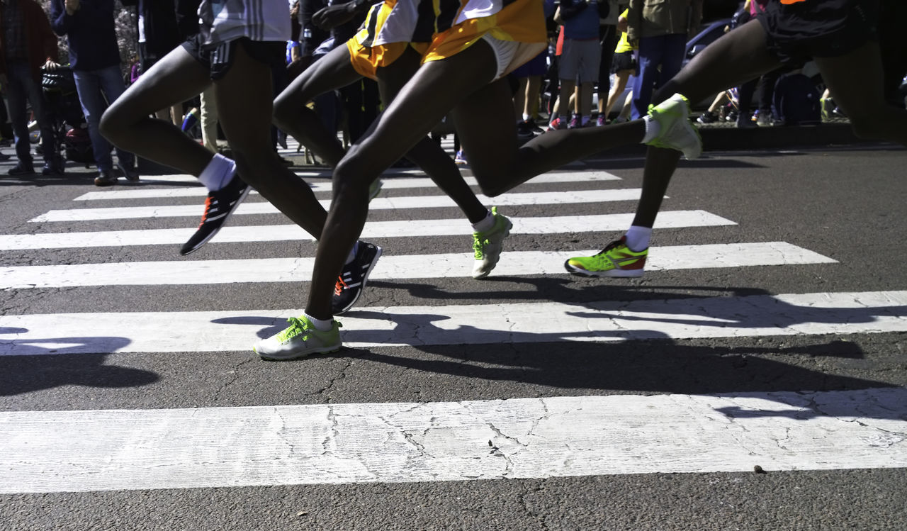runners crossing the street Black Runners City City Life City Street Crossing The Street Day Leisure Activity Lifestyles Low Section Outdoors Pavement Road Runners Running Street Sunlight Sunny Unrecognizable Person White Strips The Street Photographer - 2016 EyeEm Awards