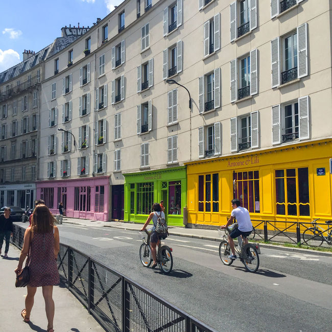 Architecture Bike Bikes Building Exterior Casual Clothing City City Life Colors Commuting Cycling Green Lifestyles Mode Of Transport On The Move Paris Pink Riding Road Square Squaready Squareinstapic Street Streetphotography Transportation Yellow