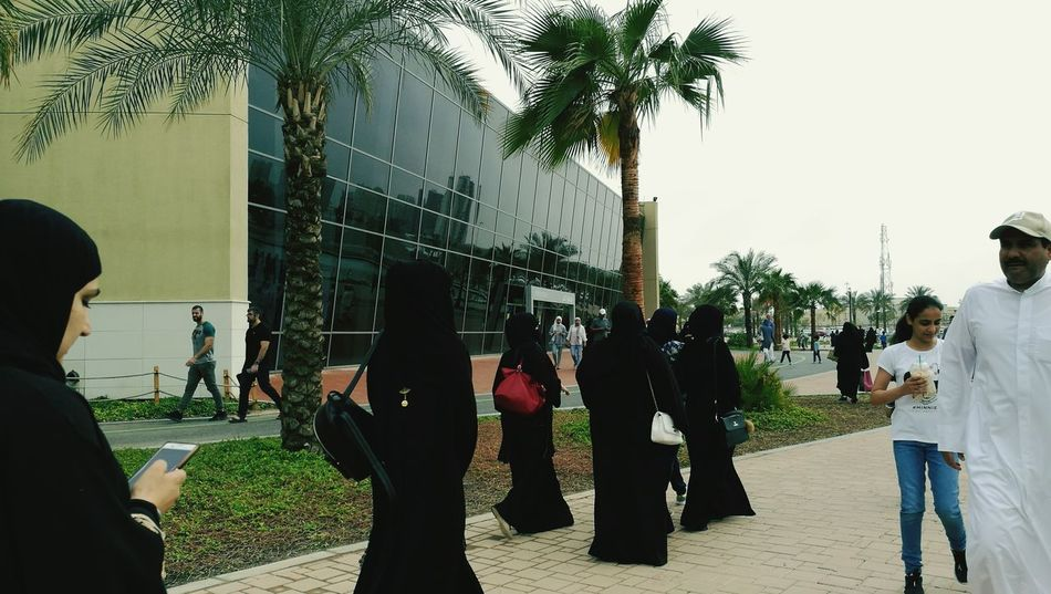 Welcome To Black Real People Outdoors Leisure Activity Winter Morning Photography Themes Street Photography Kuwait Long Goodbye Urban Photography Daytime Photography Lifestyles Togetherness Small Group Of People