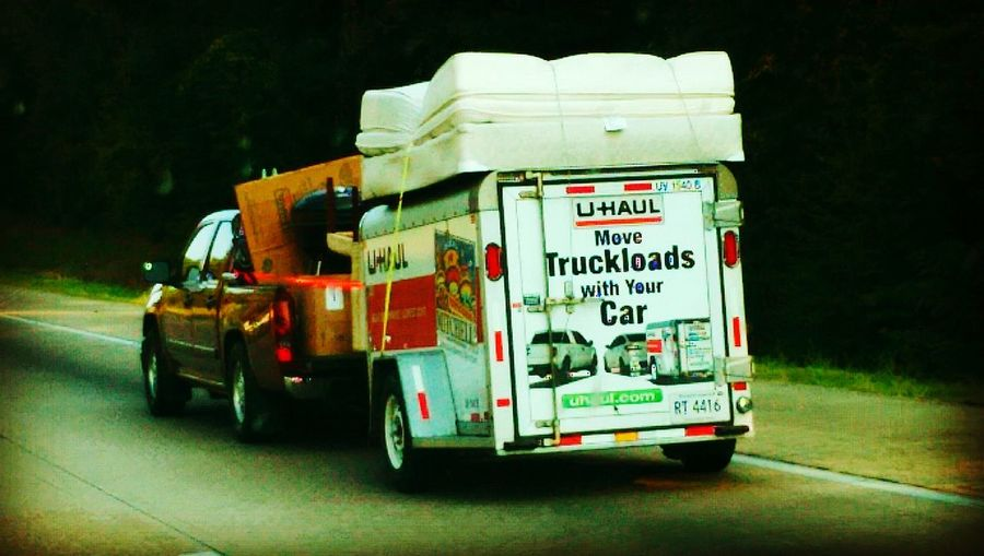 When a man swears up and down to his wife that the Uhaul is the right size he'll do anything to prove he's right. Lol :) Lol Smh  Saw this in Mississippi a few months ago...