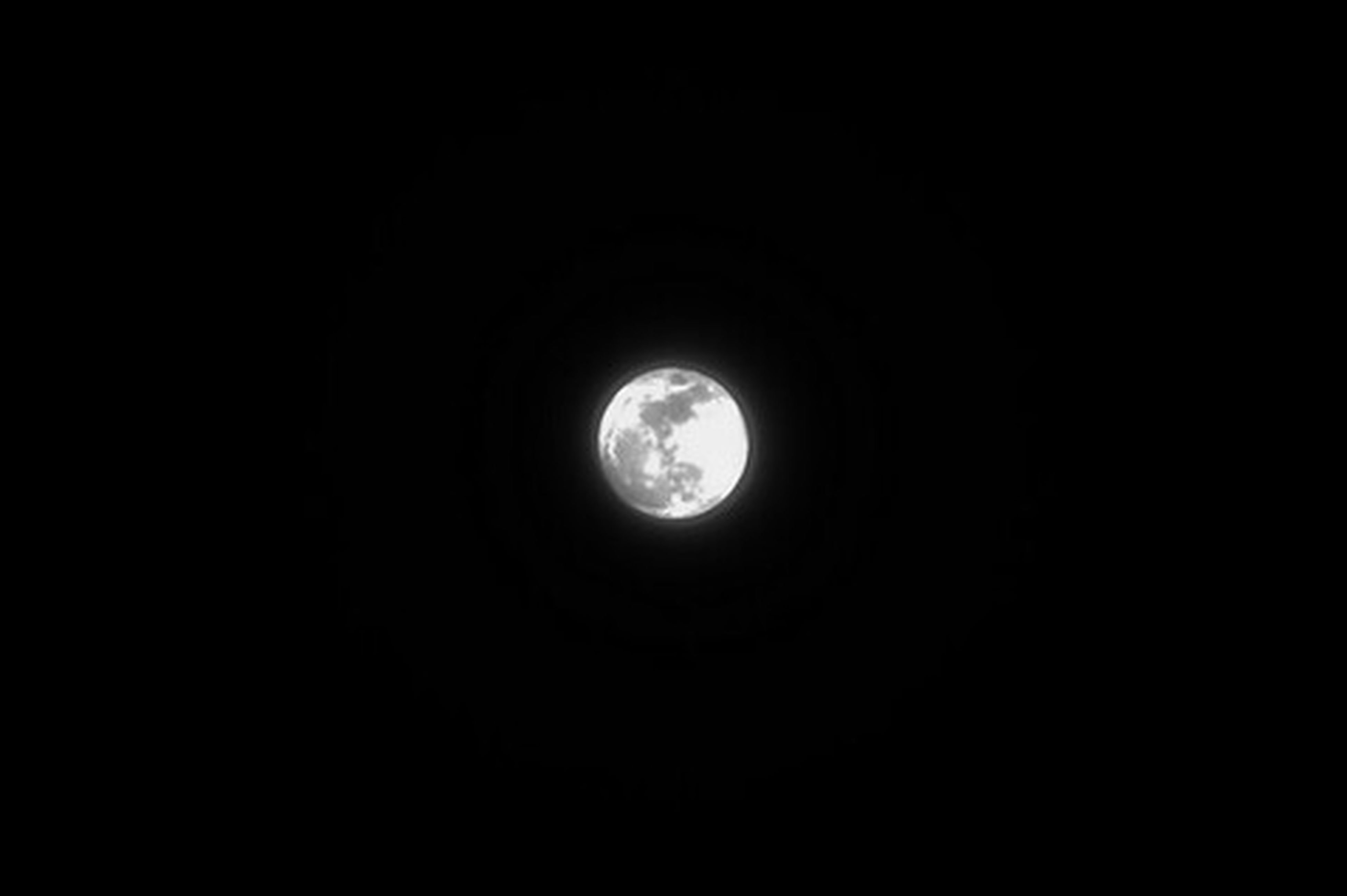 circle, dark, copy space, moon, night, astronomy, low angle view, sky, scenics, full moon, nature, beauty in nature, planetary moon, tranquility, clear sky, tranquil scene, no people, geometric shape, majestic, glowing