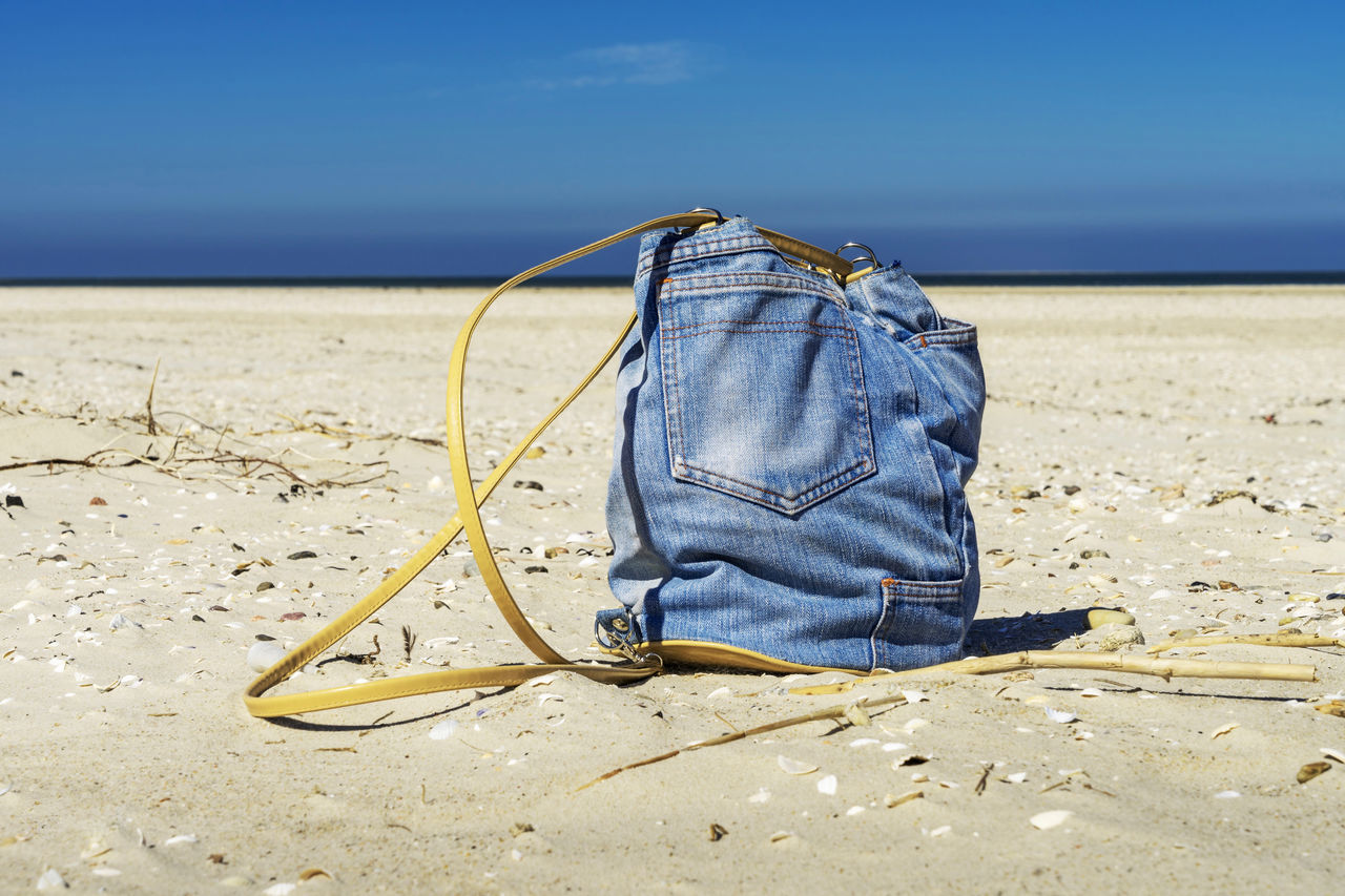 The EyeEm Collection Backpack Sommergefühle Bag Beach Blue Close-up Day Denim Denim Bag Horizon Over Water Jean Jeans Jeans On Beach Nature Amrum Sand Sea Live For The Story Water Beachphotography The Great Outdoors - 2017 EyeEm Awards BYOPaper! Selected for Premium Collection Sommergefühle