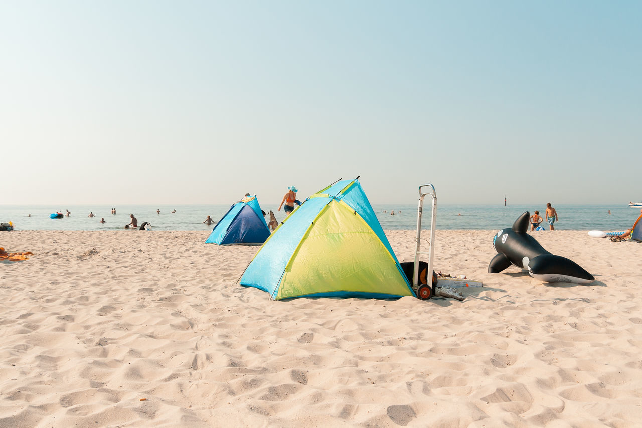 Draft shields Baltic Sea Beach Beauty In Nature Clear Sky Day Draft Shield Holidays Horizon Over Water Leisure Activity Men Nature Outdoors People Real People Relaxation Sand Scenics Sea Shore Sky Summer Sun Shield Tent Vacations Water Live For The Story
