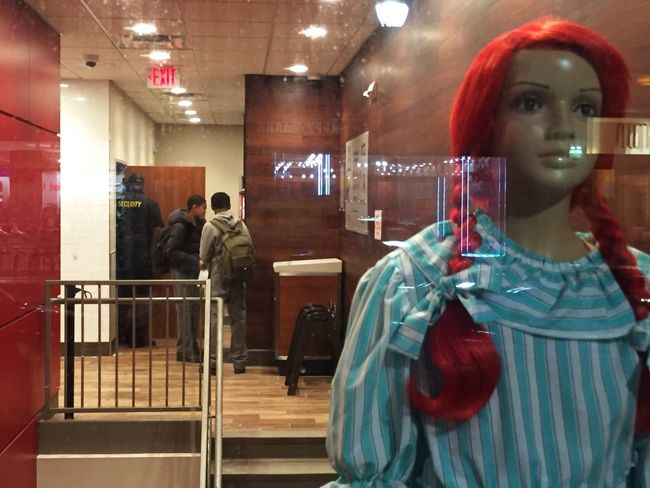 Mannequin Light Reflections Light And Shadow Nightlightlamp Exit Sign Exitsign Signs Redhair Redwall Glossy Sidewalk View Looking Through Window Reflections And Shadows Window Reflections Window Light Still Life Showing Imperfection Up Close Street Photography Telling Stories Differently Colour Of Life
