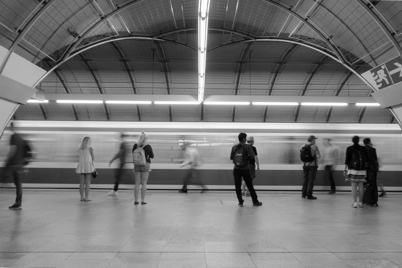 B&w City Life Convenience Illuminated Journey Medium Group Of People Modern Motion Passenger Person Public Transportation Rail Transportation Railroad Station Railway Station Speed Standing Street Photography Subway Platform Subway Station Transportation U-Bahnhof Ubahnhof Waiting Battle Of The Cities