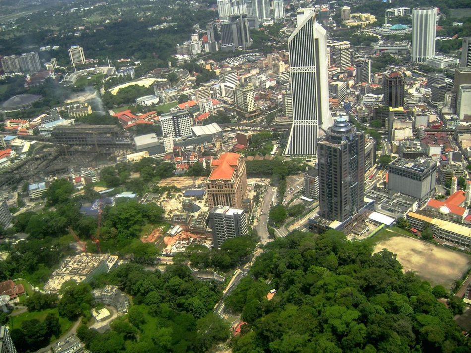 jakarta, indonesia...view from The monasBuilding Exterior Tree City Architecture Travel Destinations Built Structure Cityscape Outdoors Real People Christmas Tree Day Flying High Aerial View View From Monas Monas Indonesia Jakarta Indonesia