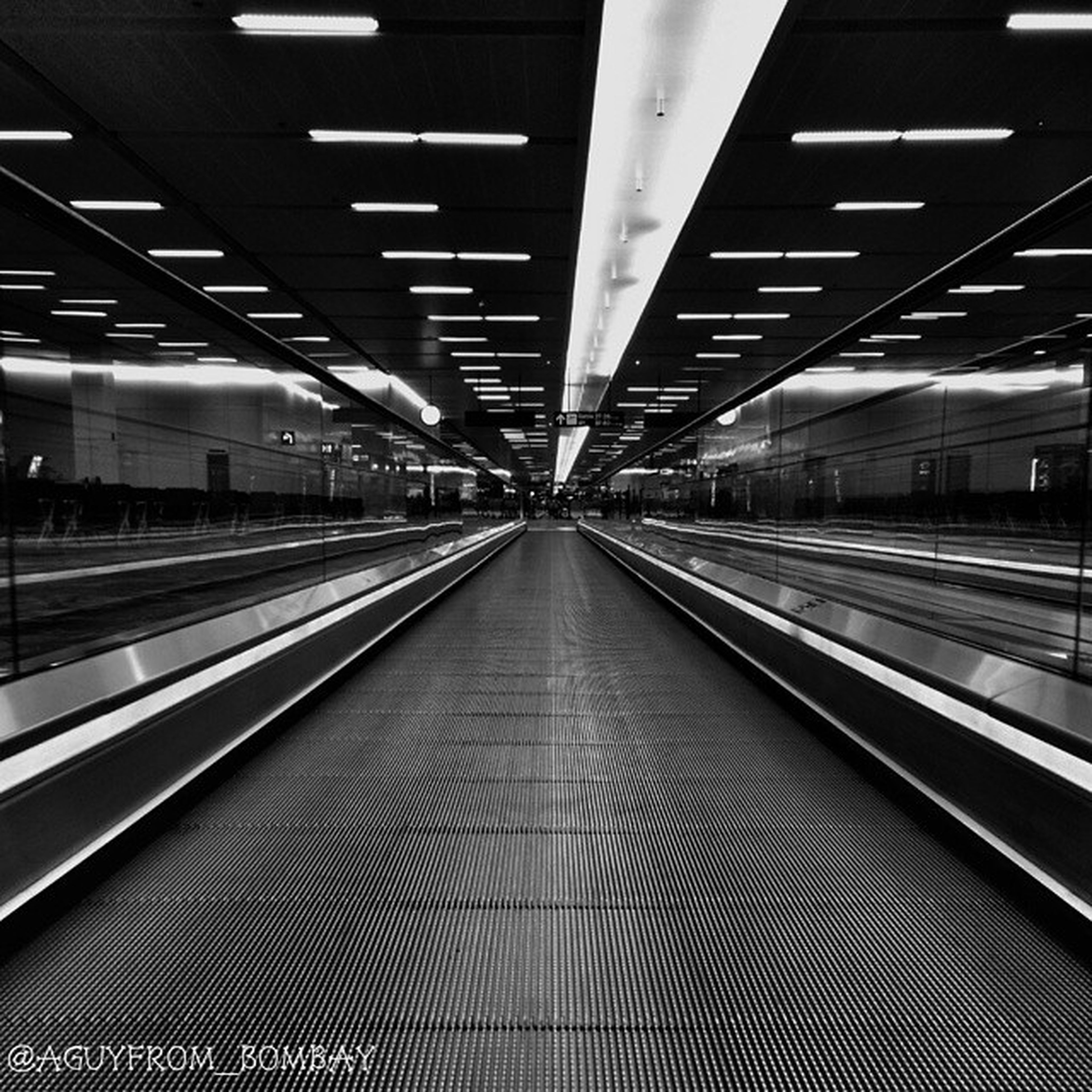 railroad track, rail transportation, diminishing perspective, indoors, transportation, the way forward, illuminated, railroad station, railroad station platform, vanishing point, public transportation, ceiling, subway station, built structure, empty, subway, architecture, long, lighting equipment, railway track