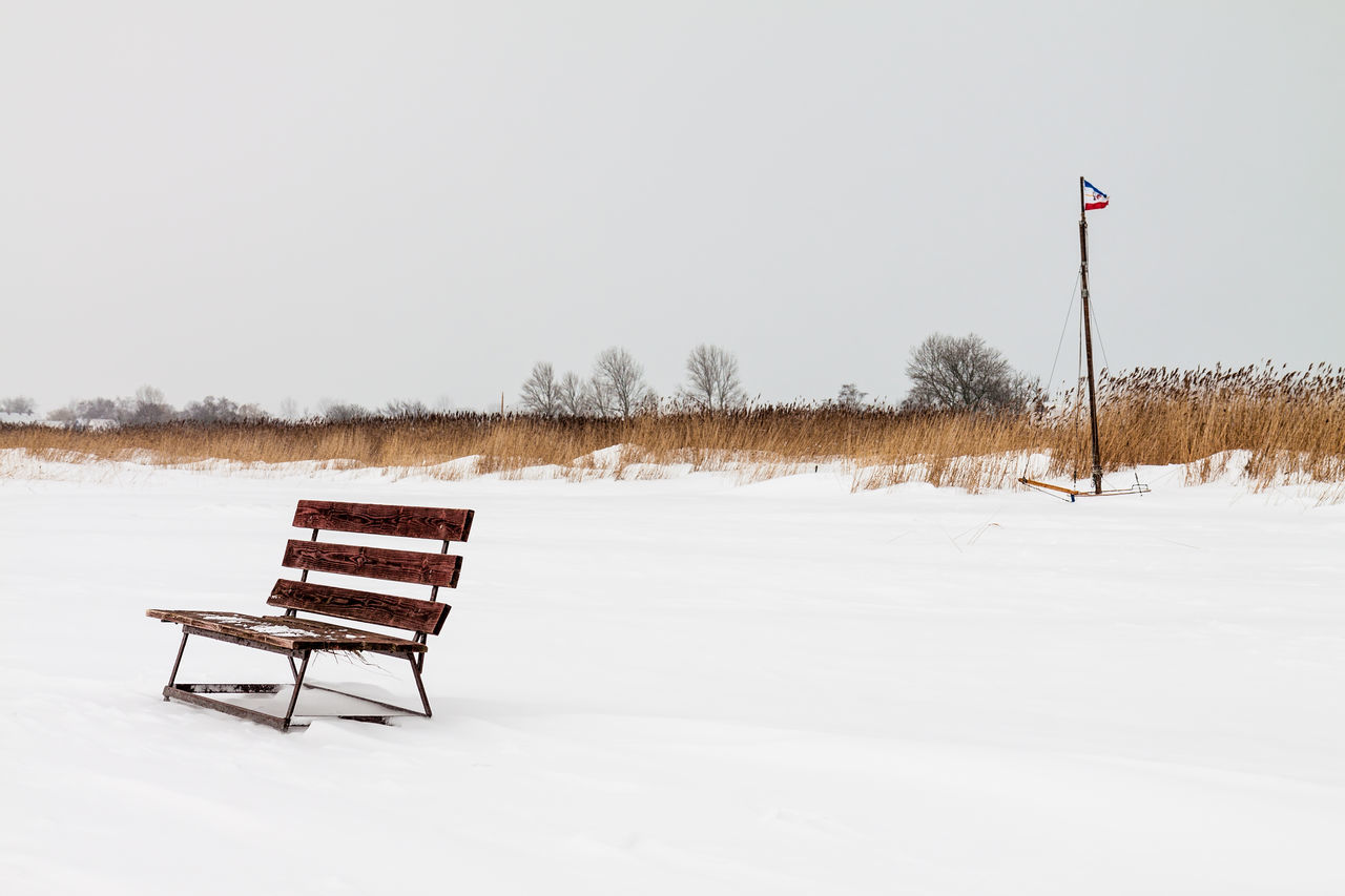 Winter on a lake. Beauty In Nature Bench Cold Temperature Day Flag Lake Landscape Nature No People Outdoors Pole Reeds Scenics Snow Winter