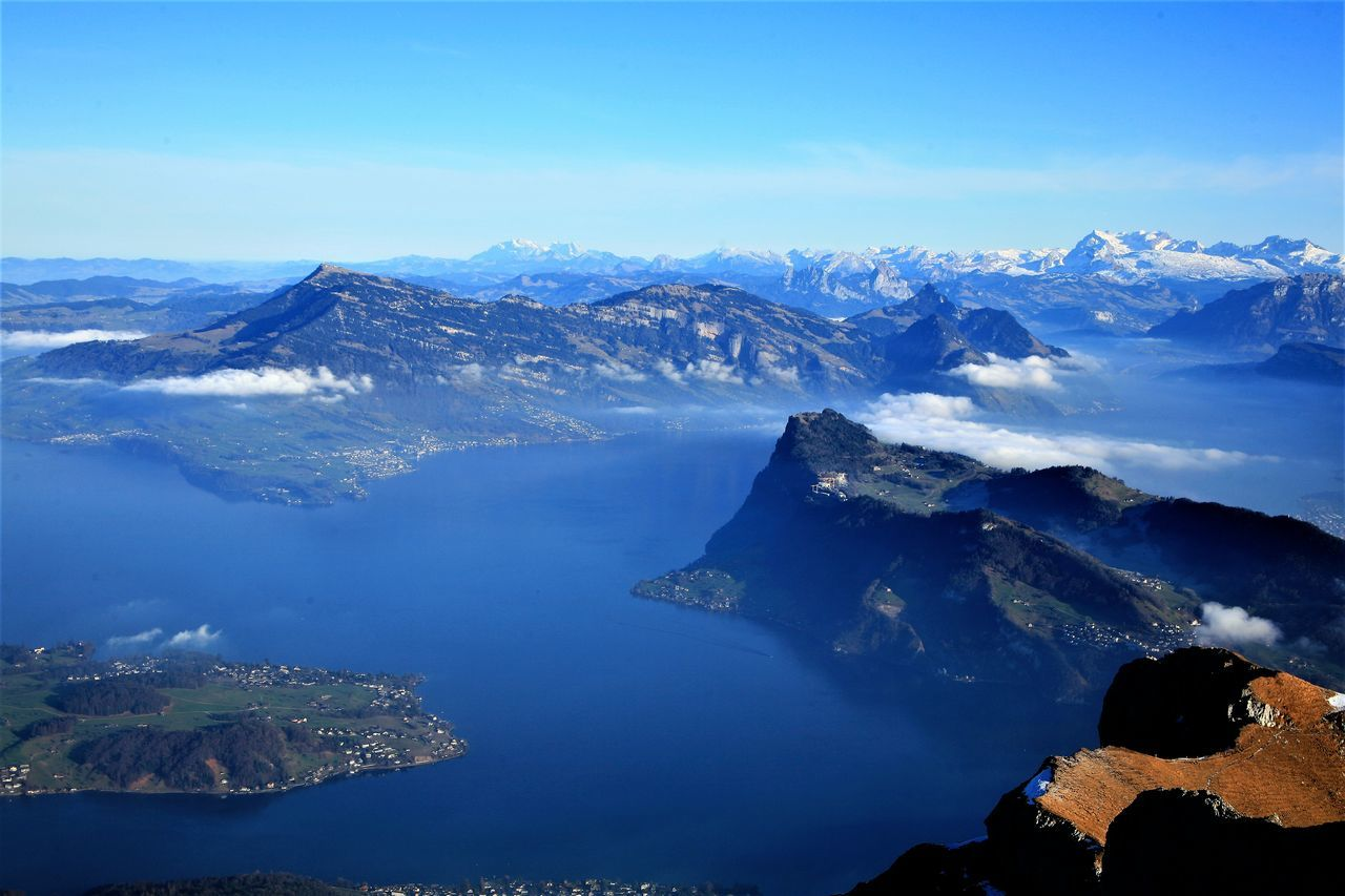 Panoramic view for Lake Luzern (Shot from the top of Mt. Pilatus) Beauty In Nature Blue Cloud - Sky Cold Temperature Day Europe Idyllic Landscape Mountain Mountain Peak Mountain Range Nature No People Outdoors Panorama Reflection Scenics Sea Sky Snow Tranquil Scene Tranquility Travel Destinations Water Winter
