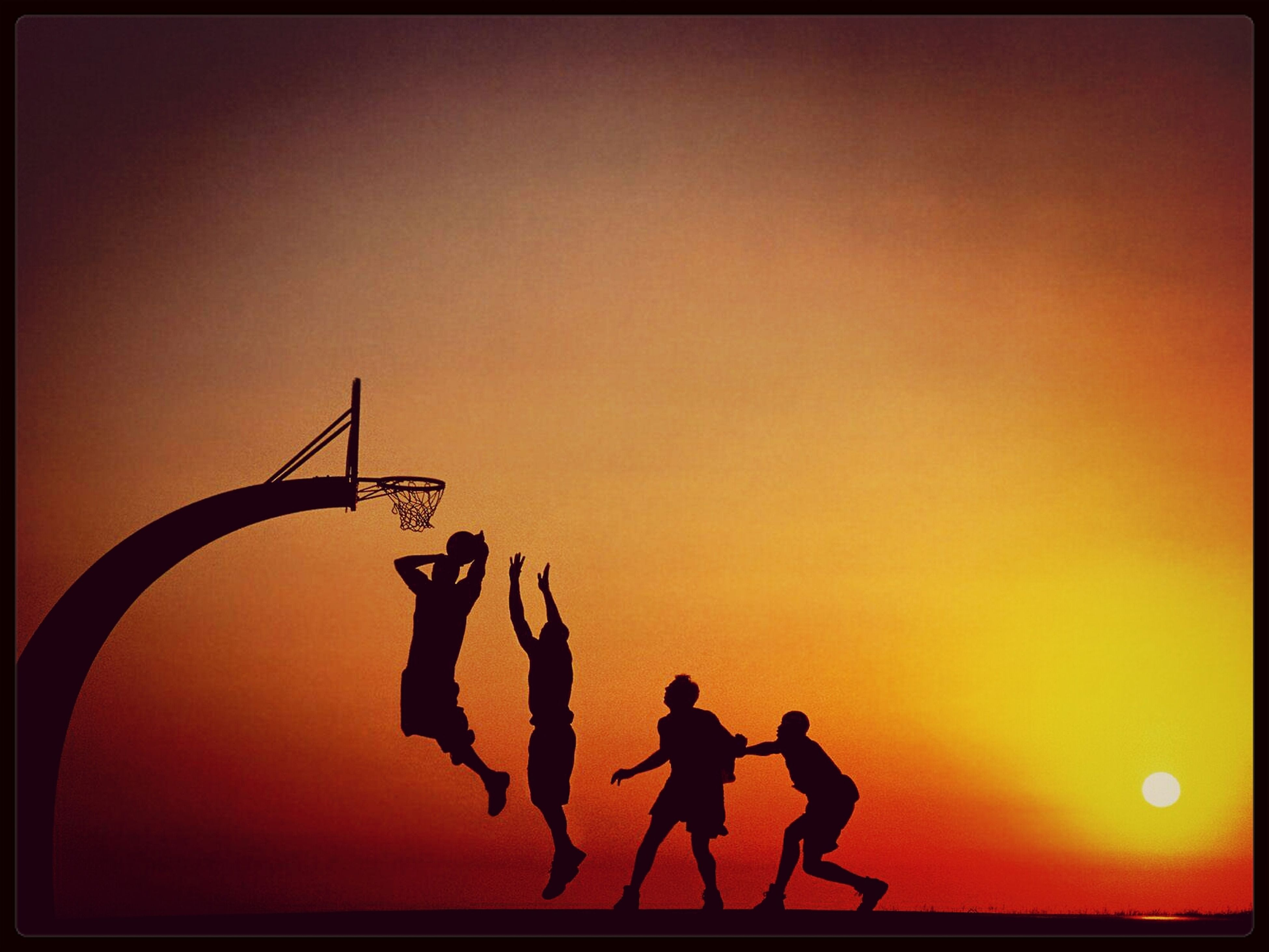 transfer print, sunset, auto post production filter, orange color, silhouette, leisure activity, lifestyles, men, togetherness, sky, sun, copy space, clear sky, enjoyment, full length, standing, fun