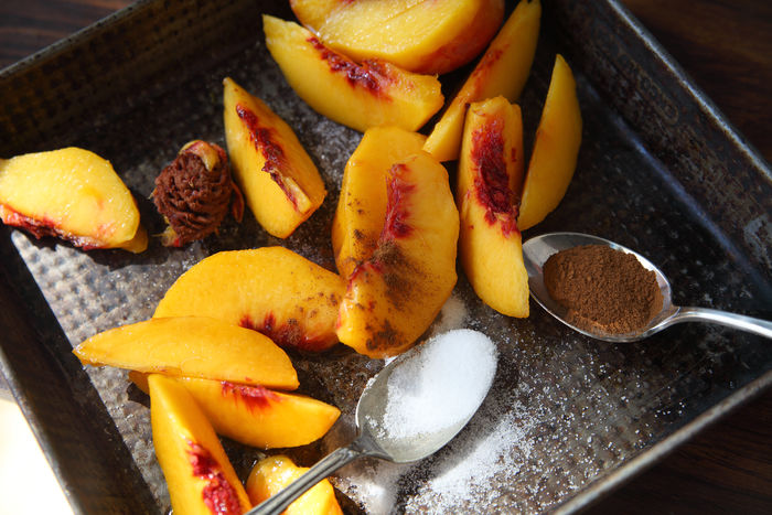 Fresh peeled peaches with cinnamon Cinnamon Close-up Food Food Preparation Group Of Objects Indoors  Natural Light Overhead Peaches Red Ripe Seasonal Sliced Fruit Spoon Sugar Summer Sweet Textures Vintage Pan Yellow
