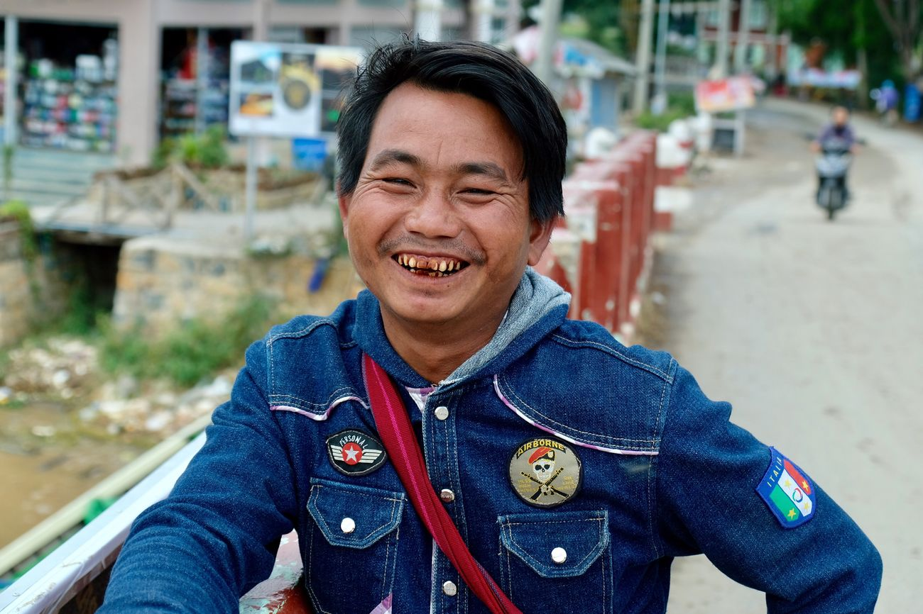 Real People Smiling Lifestyles One Person Posing Smile Teeth Chewing Happiness Cheerful Outdoors Front View Black Hair Portrait Happiness Simplicity Man Day Adult Travel Traveling Check This Out Popular Photos in Nyaungshwe , Myanmar