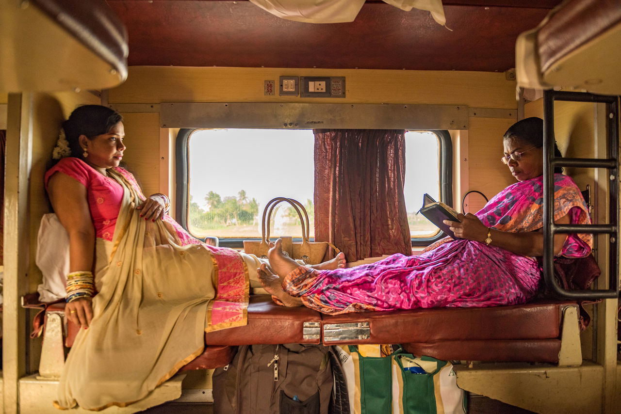 "Three generations. Mother and mother-to-be make use of the bench inside the ac-sleeper carriage to relax during their long travel through Tamil Nadu, India (Nikon D810 24.0-70.0 mm f/2.8 ƒ/2.8 24.0 mm 1/160"" iso 400) Adult Adults Only ASIA Colorful Family Grand Mother India Journey Mother Only Women Passenger People Pregnant Tamil Nadu Togetherness Traditional Clothing Travel Two People Women"
