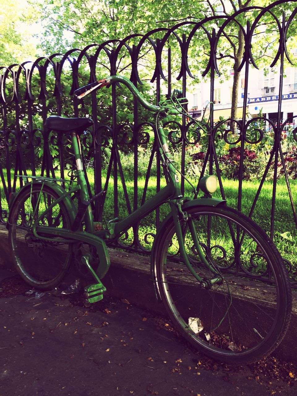 Green Bicycle Parked By Railing