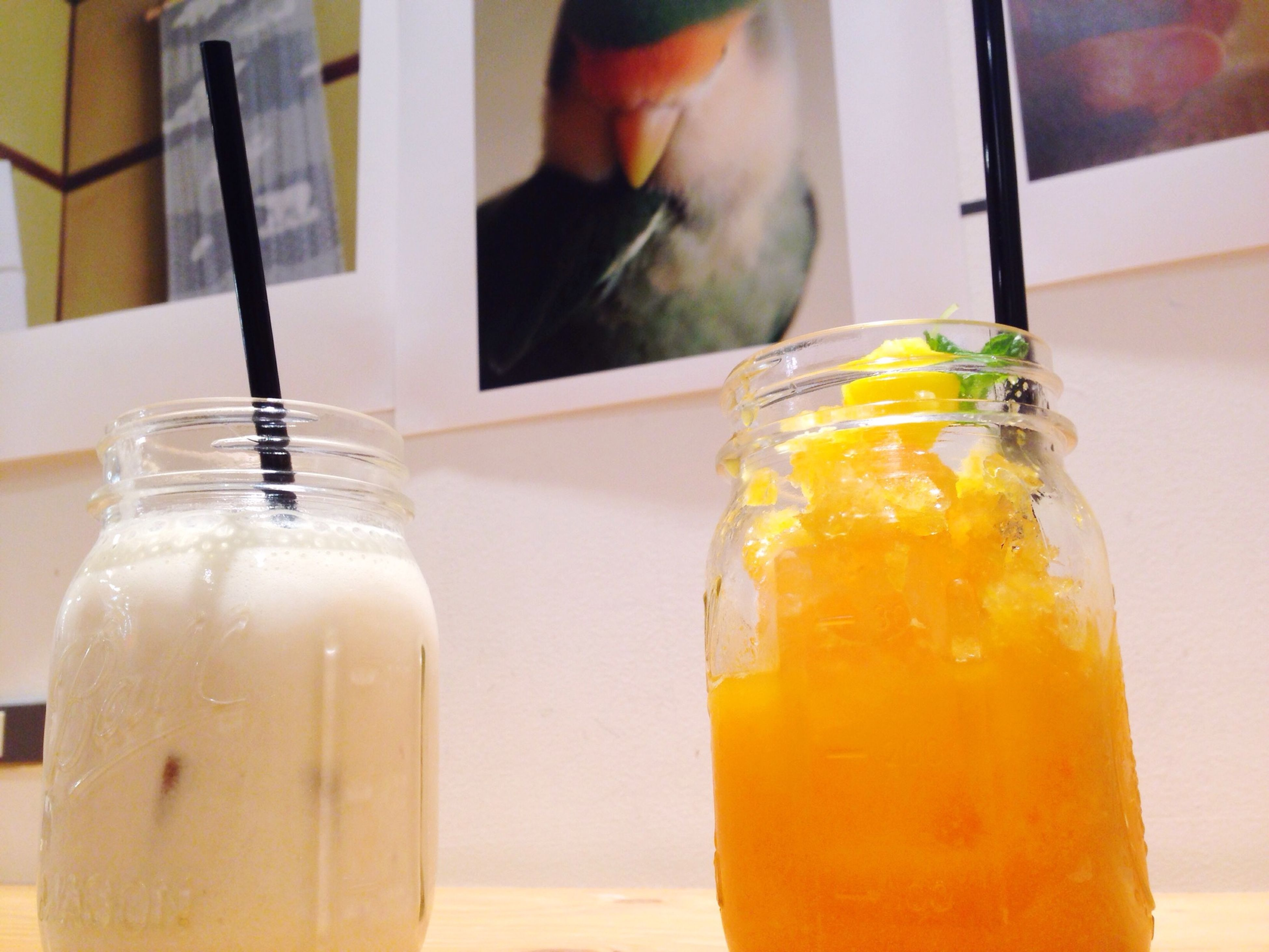 food and drink, drink, refreshment, drinking glass, freshness, yellow, drinking straw, indoors, alcohol, table, close-up, juice, glass - material, healthy eating, focus on foreground, cocktail, glass, still life, food, fruit