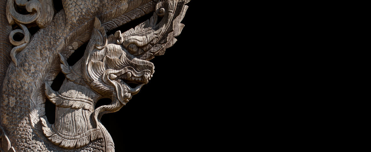 statue, sculpture, black background, no people, low angle view, lion - feline, outdoors, close-up, gargoyle, day, chinese dragon