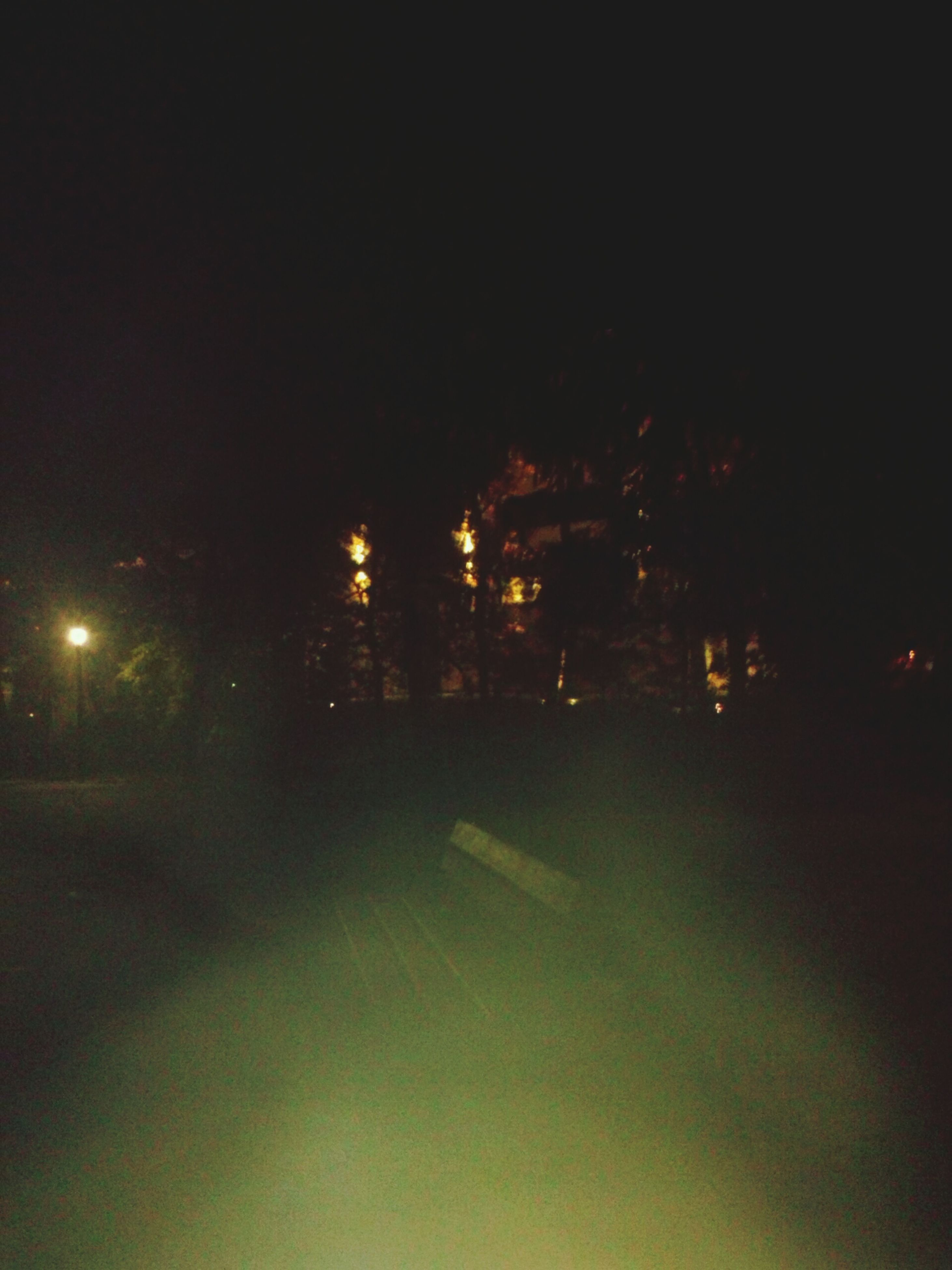 night, illuminated, street light, street, road, transportation, copy space, tree, clear sky, dark, lighting equipment, the way forward, car, light - natural phenomenon, outdoors, silhouette, no people, land vehicle, city, building exterior