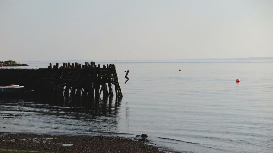 Boy jumping of pier. Sea Nature Water Outdoors Sky Tranquility Beach Beauty In Nature Day Motion Swimming Jumping Summer ☀ Summertime Summer Holidays