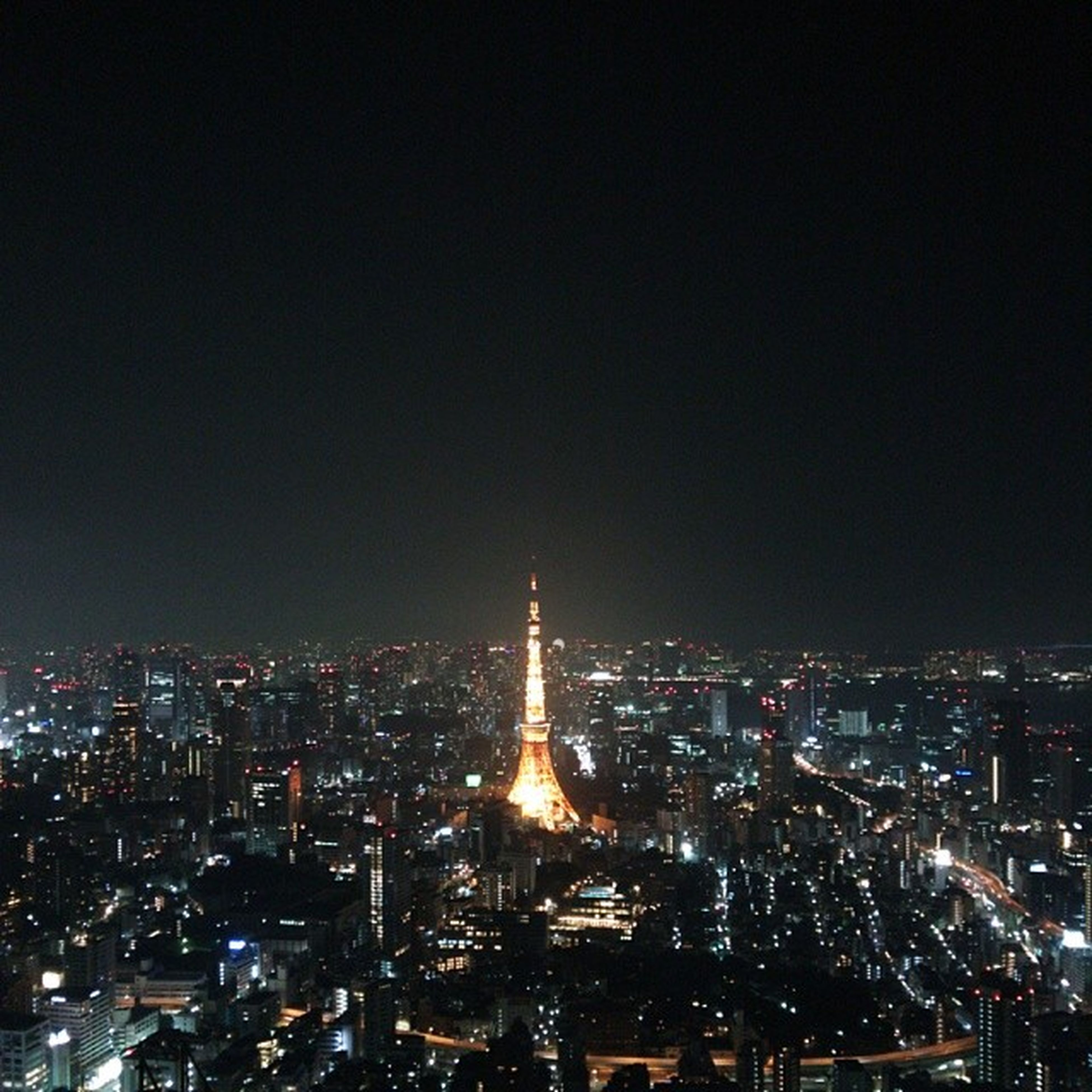 night, illuminated, city, cityscape, architecture, building exterior, built structure, crowded, skyscraper, modern, high angle view, capital cities, tower, city life, copy space, tall - high, office building, clear sky, sky, travel destinations