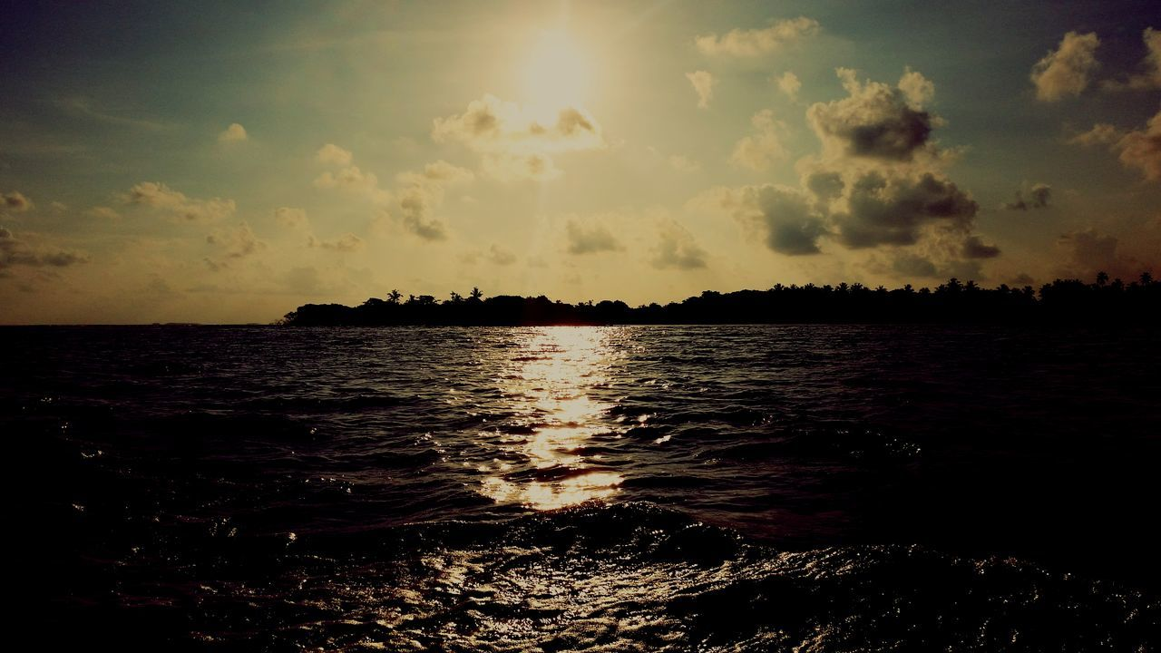sea, sunset, nature, water, sky, tranquility, beauty in nature, scenics, silhouette, tranquil scene, sun, no people, sunlight, outdoors, beach, horizon over water, day
