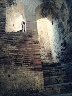 Walking Full Length Real People Day Outdoors People Adult Adults Only Ancient Italica Abandoned Old Ruin History Ruins One Young Woman Only Only Women Indoors  Women Architecture Sitting Shadow Castle Brick Wall One Person Steps Built Structure Lifestyles Indoors