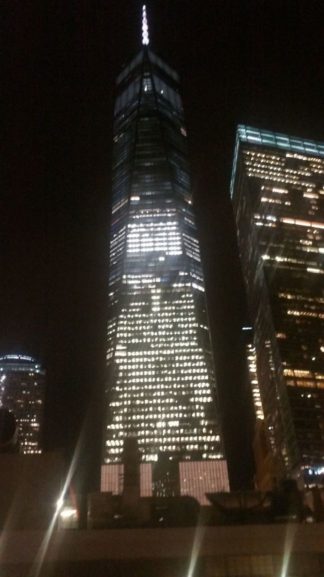 Architecture Building Exterior Built Structure Skyscraper Illuminated Tower Tall - High Night Low Angle View City Modern Office Building Development Sky Cityscape Tall Urban Skyline Financial District  Travel Destinations City Life
