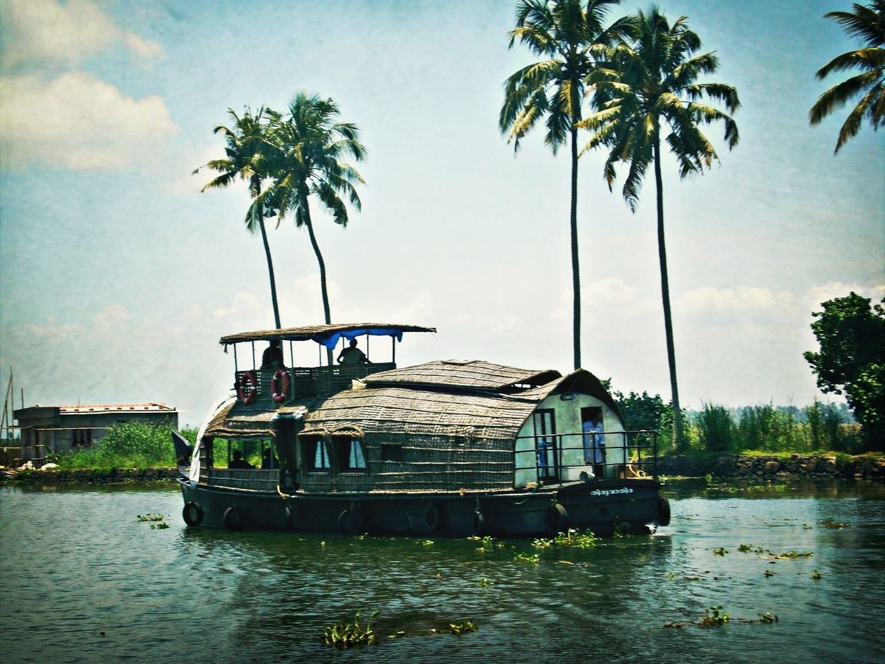 nautical vessel, transportation, tree, water, mode of transport, waterfront, boat, houseboat, day, palm tree, lake, moored, nature, outdoors, no people, sky, beauty in nature, architecture