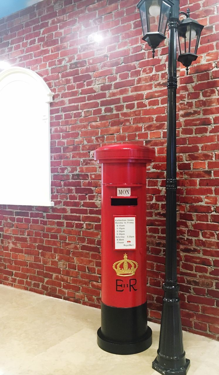 red, brick wall, architecture, communication, no people, built structure, day, text, public mailbox, building exterior, outdoors