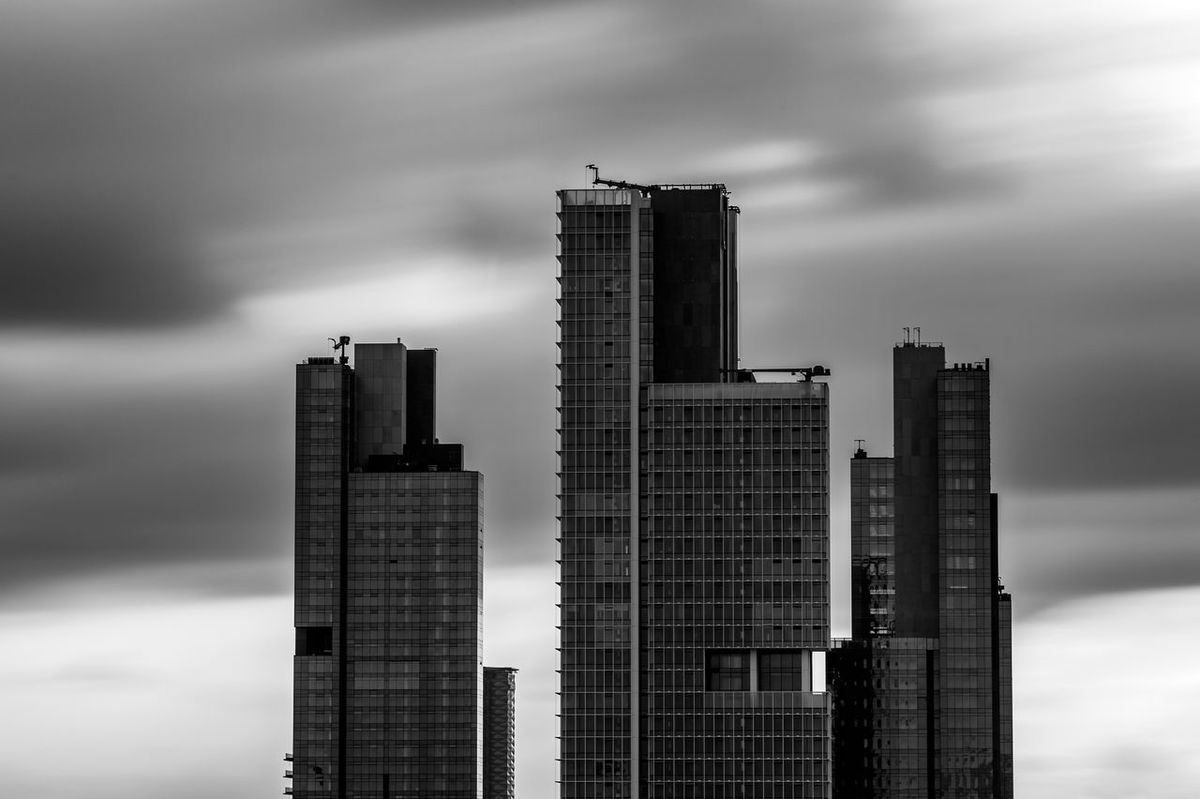 Invisible Beast (black & white) (looks a bit like gun barrels pointed at the fresh air)Architecture Behemoth Black And White Blackandwhite Building Exterior Business Finance And Industry capturing motion Cityscape Cityscapes Clouds And Sky Downtown District Istanbul Long Exposure Monochrome Monochrome Photography No People Outdoors Skyline Skyscraper Storm Cloud Sunset Sunset Silhouettes Sunset_collection Urban Skyline Vertical Welcome To Black