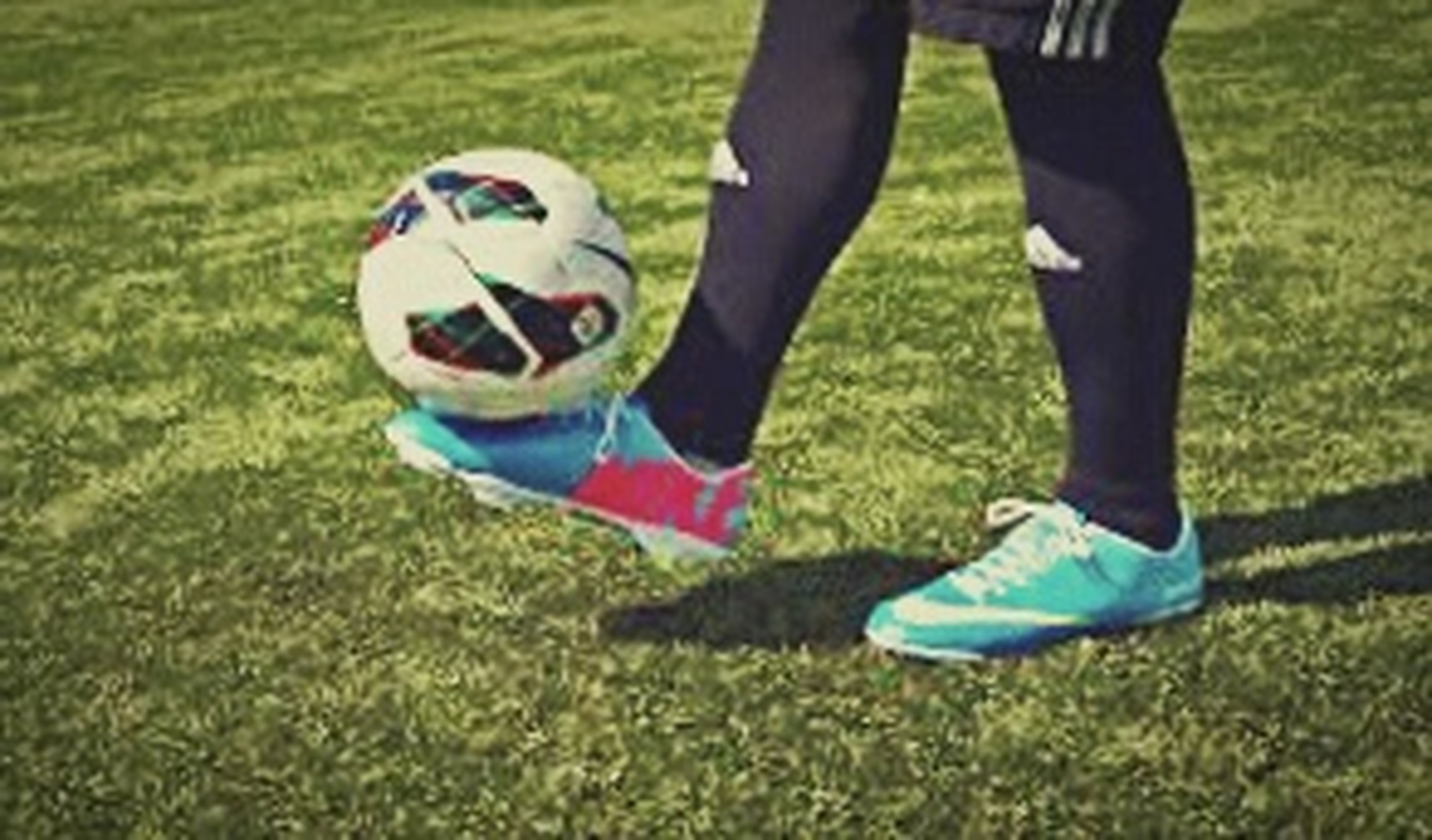 grass, lifestyles, leisure activity, low section, field, grassy, childhood, person, sport, men, shoe, casual clothing, green color, boys, day, outdoors, playing, park - man made space