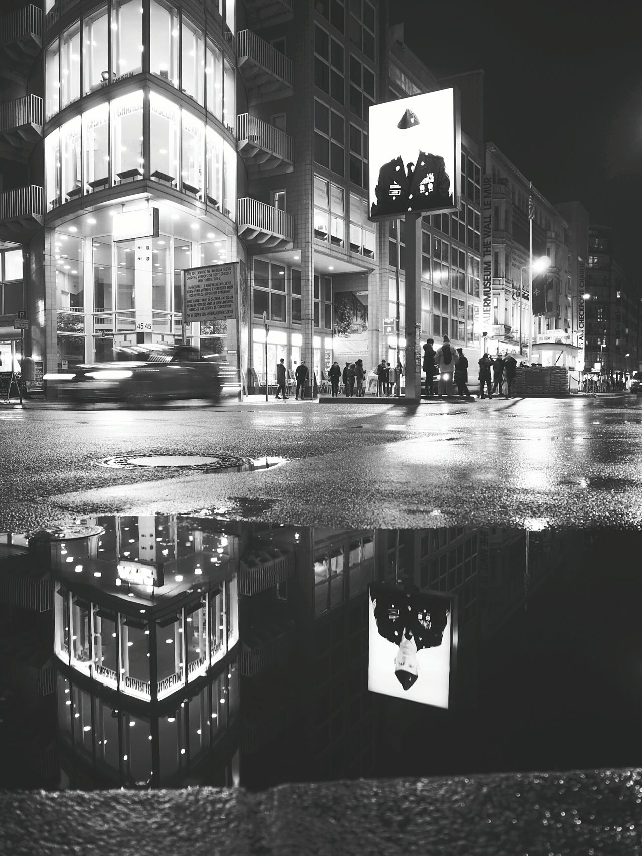 Soldier in a Puddle - at Checkpoint Charly in Berlin Reflection Water Night Outdoors Architecture Illuminated Checkpointcharlie Berlin Streetlights Road Soldier Winter Cold Day Rain Welcomeweekly EyeEmNewHere Blackandwhite EyeEmNewHere