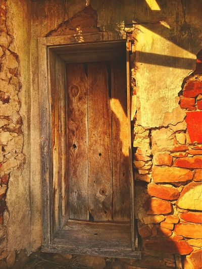 """""""Mystery Ranch No. 10"""" A Door With No Handle. Plaster Brick New Mexico Photography New Mexico Abandoned Buildings Abandoned Places Abandonded Weatheredwood Doors Door Architecture Built Structure No People Day Wood - Material Building Exterior"""