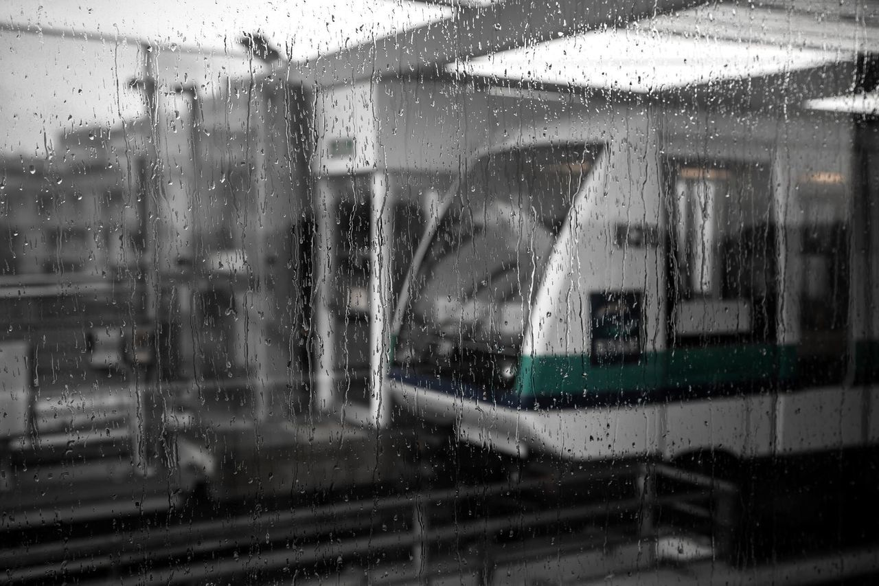 window, rain, glass - material, transportation, wet, rainy season, weather, mode of transport, vehicle interior, train - vehicle, rainfall, raindrop, drop, public transportation, windshield, land vehicle, day, water, looking through window, car, no people, snowing, outdoors, car wash, commuter train, close-up
