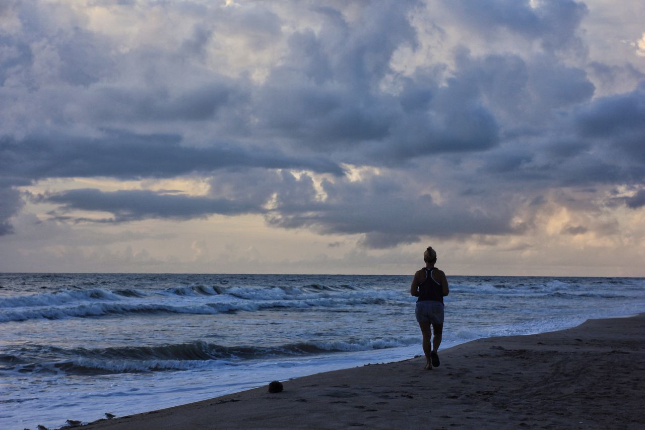 Early morning beach jogger Beach Jogger Jogger Horizon Over Water Storm Clouds Beach Solitude Leisure Activity Exercising Melbourne Beach, FL Cloud - Sky Oceanscape