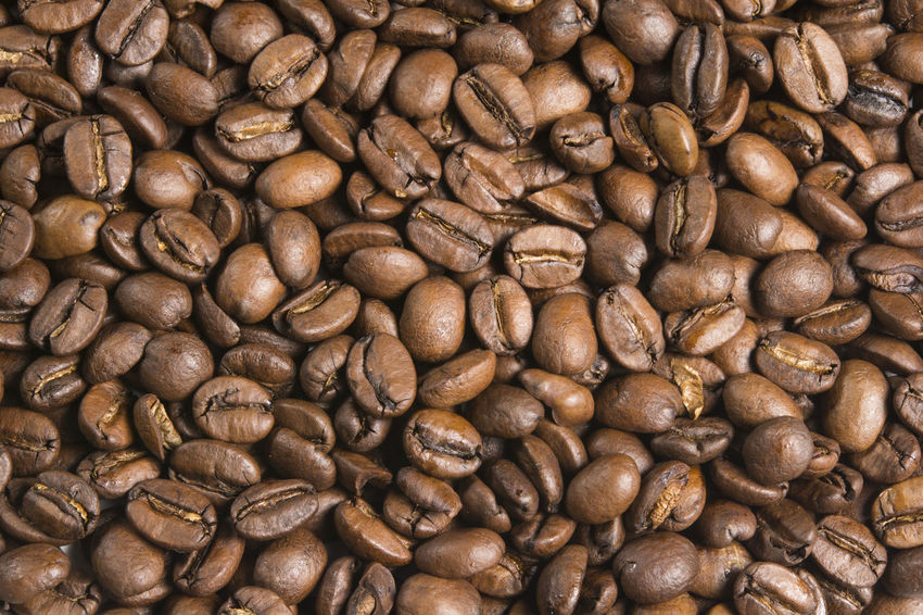 Close up of fresh coffee beans Caffeine Coffee Espresso Mocha Raw Stack Arabica Aroma Aromatic Backgrounds Bean Brown Cafe Drink Flavor Food Fresh Group Heap Many Pattern Pile Roasted Scented Texture