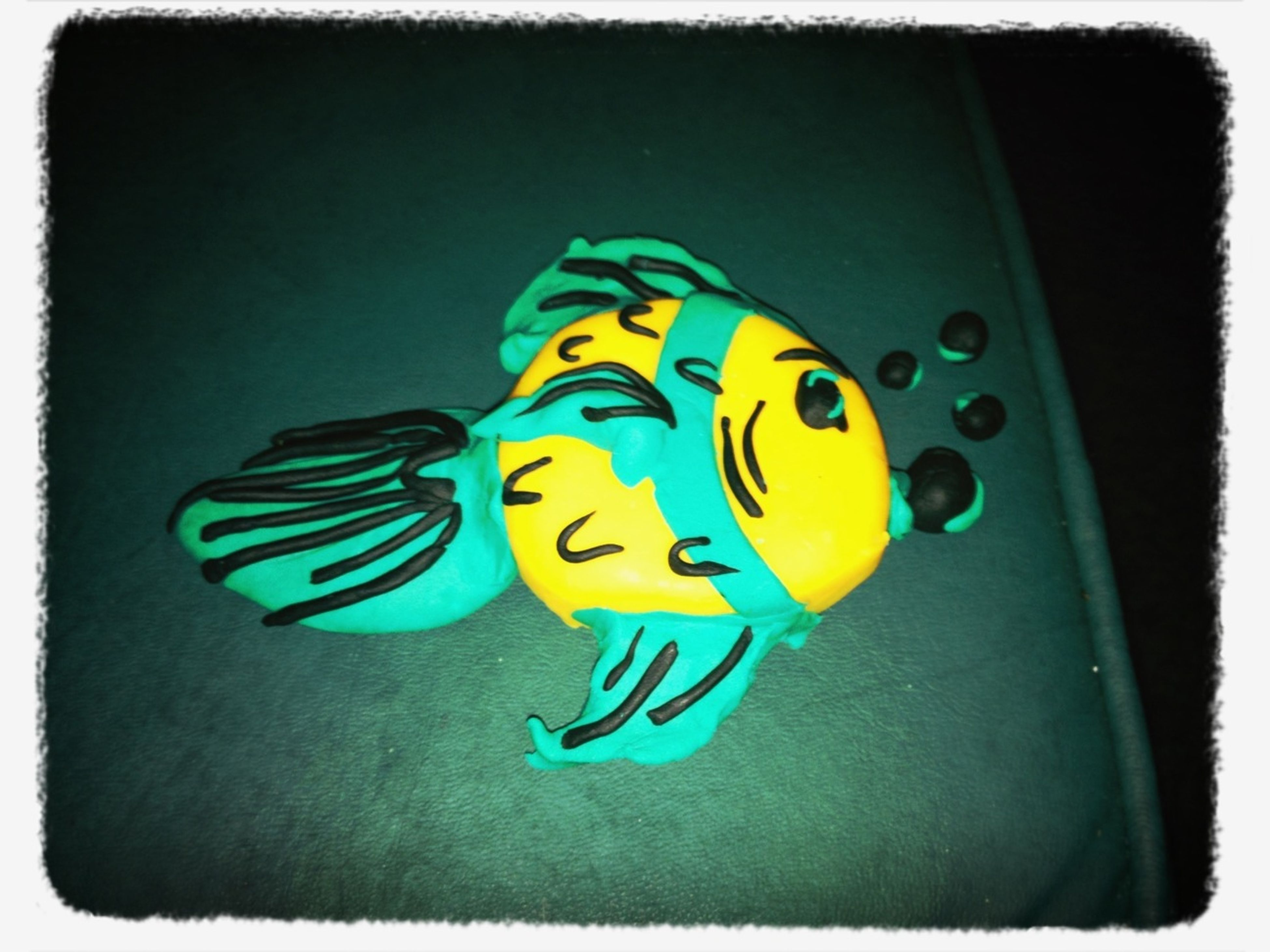 transfer print, art and craft, auto post production filter, art, creativity, multi colored, blue, animal representation, toy, still life, yellow, close-up, human representation, single object, no people, vignette, colorful, high angle view, craft