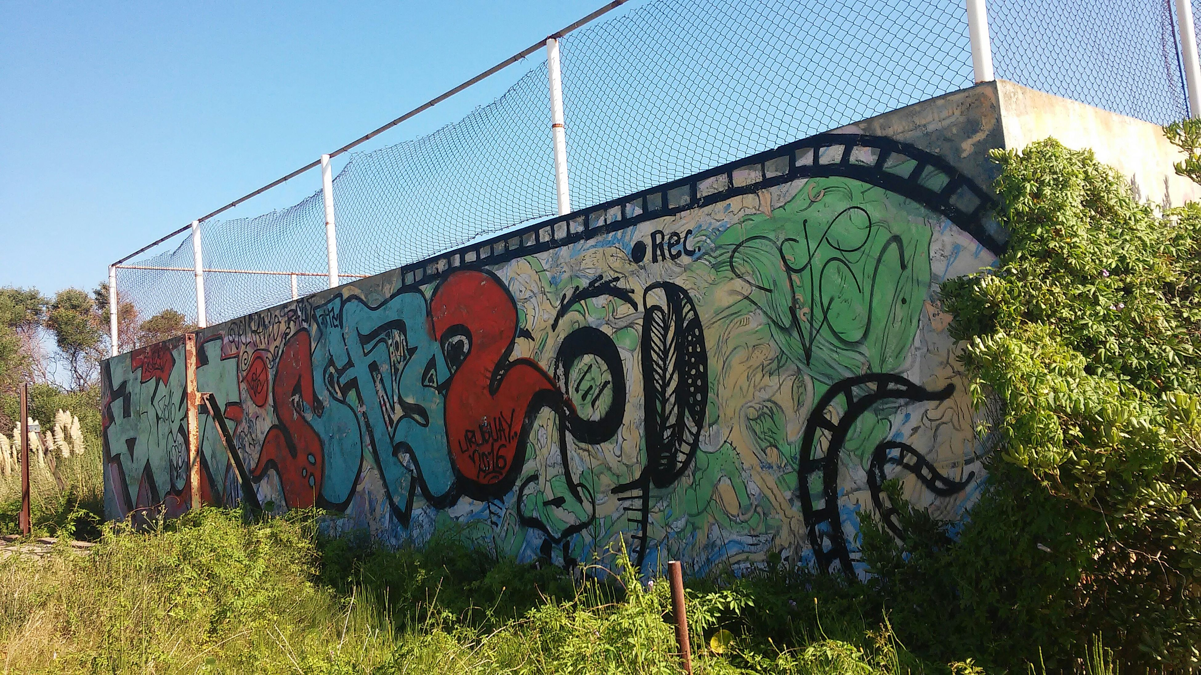 graffiti, communication, text, no people, spray paint, outdoors, close-up, day