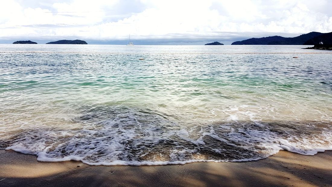 Sea Beach Water Sand Scenics Sky Cloud - Sky Nature Travel Destinations Outdoors Landscape Horizon Over Water Tranquility Vacations Day Beauty In Nature No People Summer Blue Wave Sunny Sea Water
