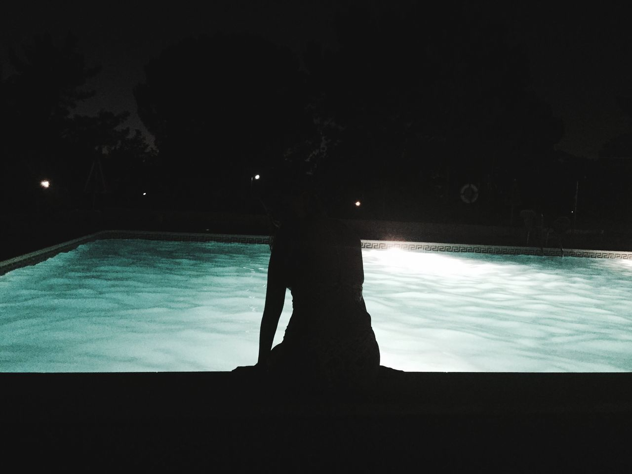 water, swimming pool, silhouette, one person, real people, standing, night, outdoors, sky, nature, tree, close-up, people