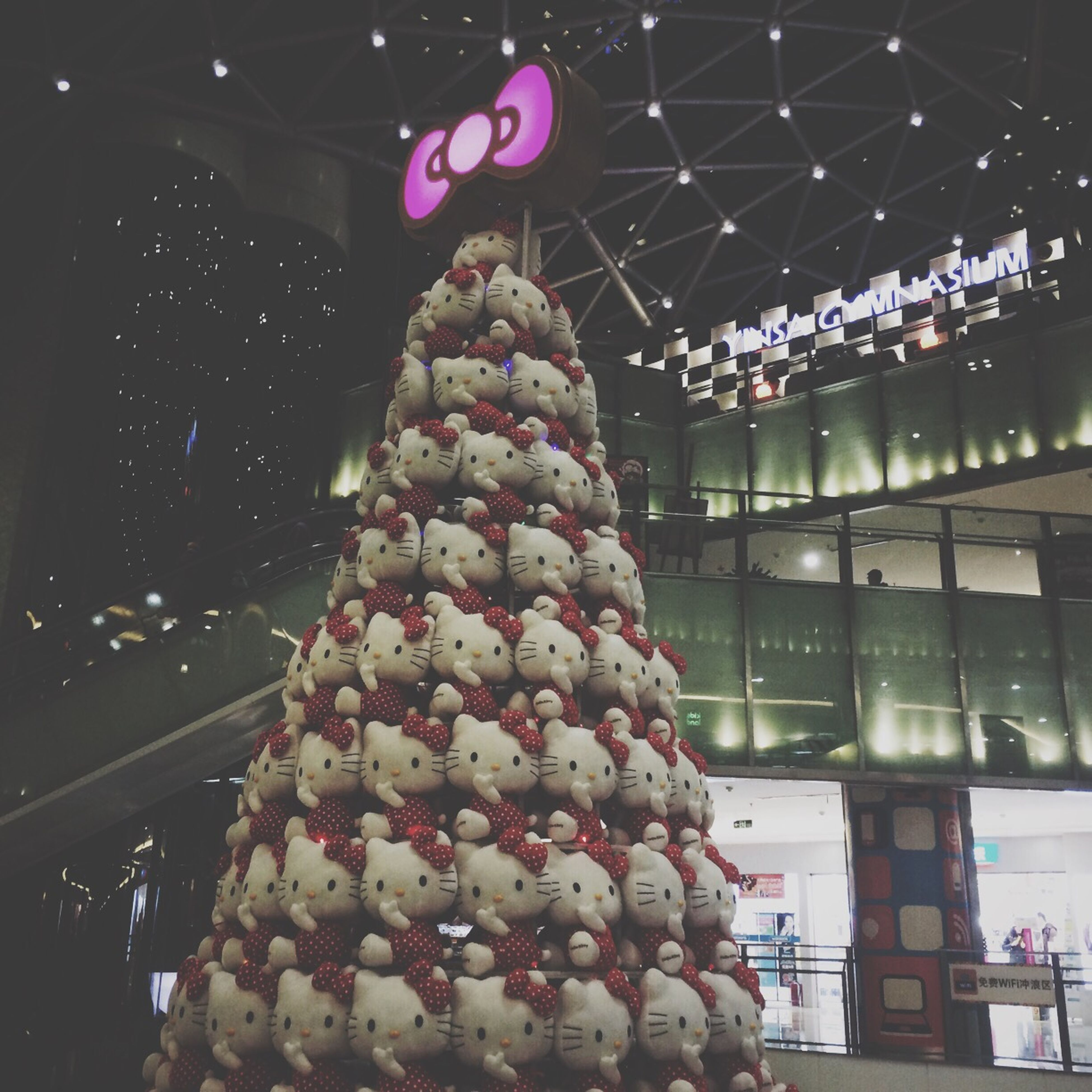 food and drink, food, freshness, sweet food, indoors, night, dessert, decoration, illuminated, celebration, unhealthy eating, hanging, glass - material, ready-to-eat, christmas, low angle view, indulgence, architecture, no people, close-up