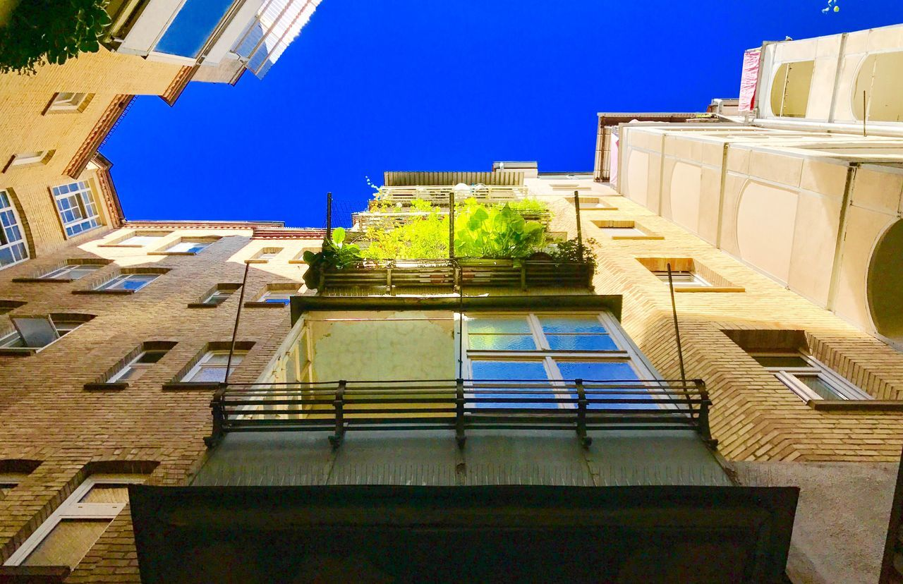 architecture, building exterior, built structure, clear sky, low angle view, blue, day, outdoors, no people, city, sky