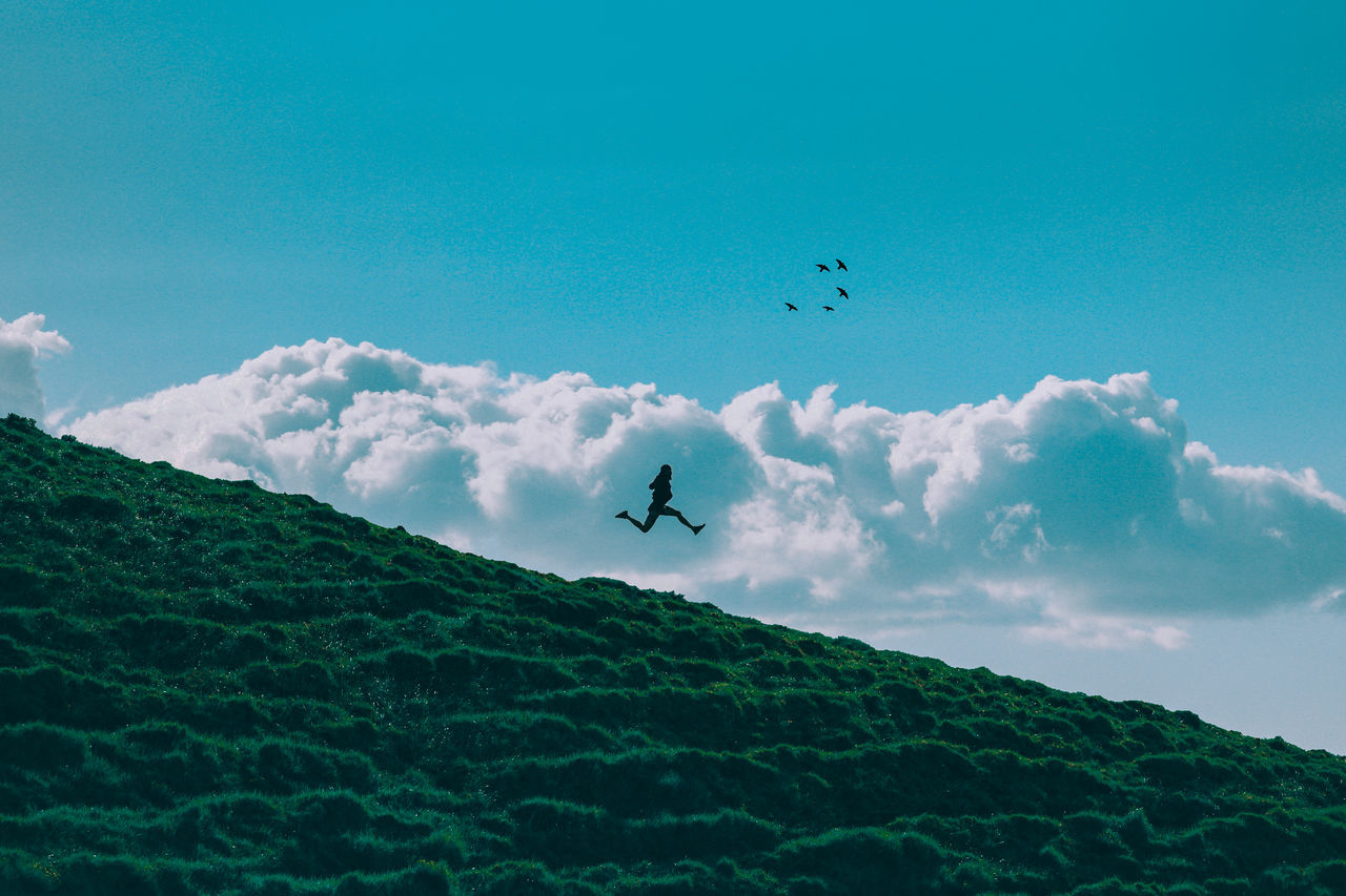 // one can't find peace by avoiding life // Adventure Air Vehicle Airplane AMPt Community AMPt_community Beauty In Nature Cloud - Sky Day EyeEm Flying Happy Landscape Mid-air Mountain Nature Outdoors Paragliding Scenics Shootermag Silhouette Sky Teamwork Tranquil Scene Transportation Unsplash