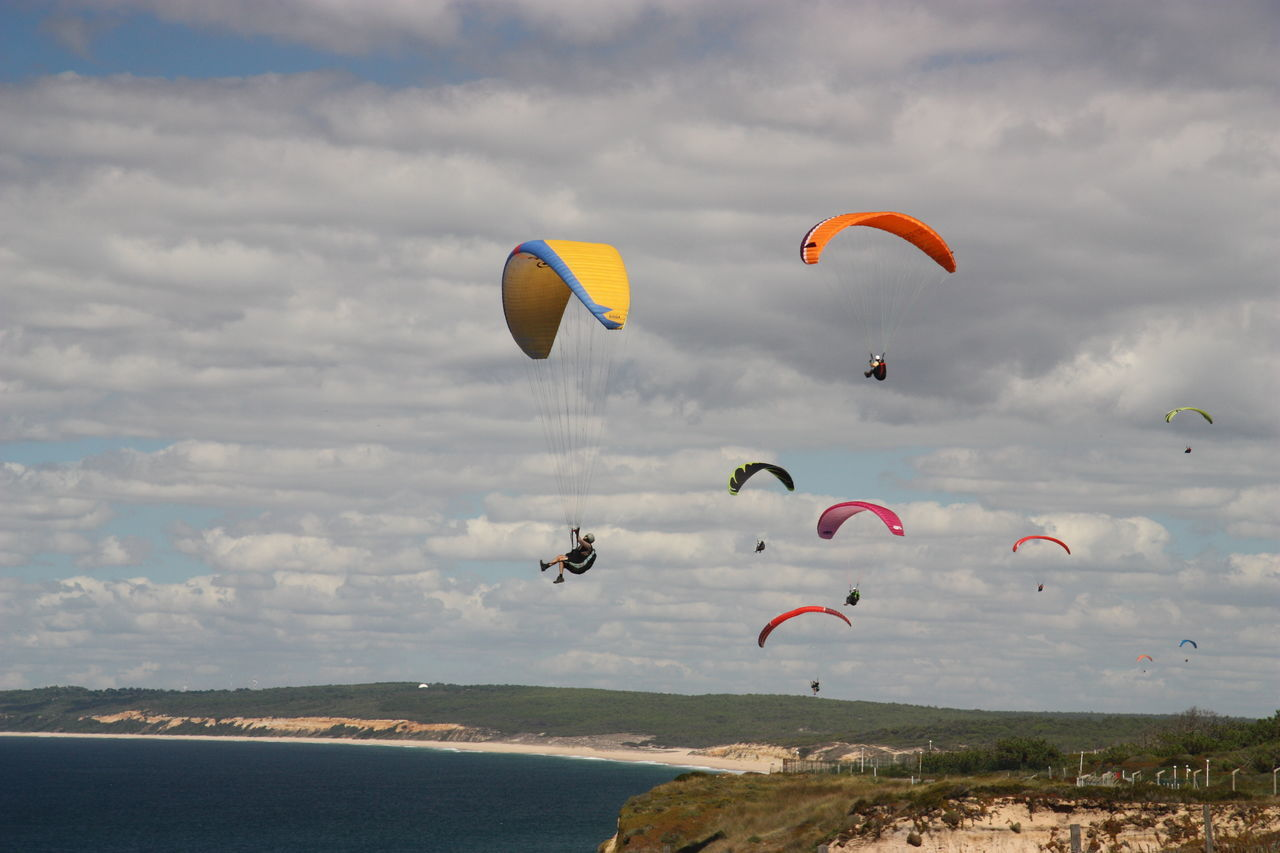 ASA At The Beach Aviate Beauty In Nature Bougie Clear Sky Cloud - Sky Cloudy Fleet Flow  Fly Multi Colored Paraglider Paragliders Paragliding Parasail Parasailing Parasailor Sail Shore Summer Vela Vibrant Color Wind Wing